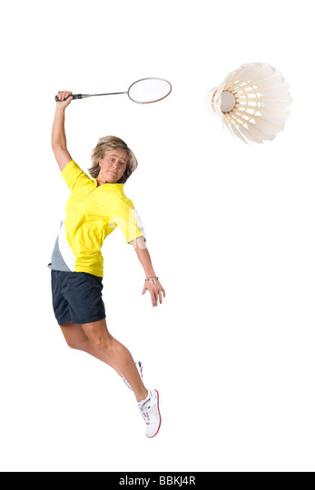 Full isolated picture of a caucasian woman playing badminton - Stock Image