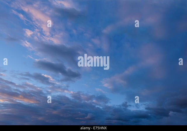 Clouds in a dusk sky - Stock Image