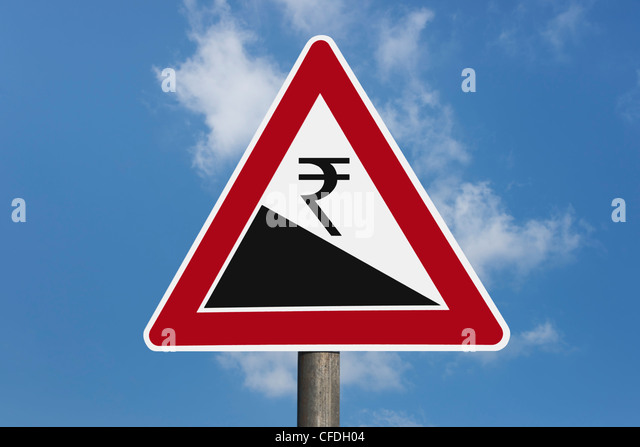 Detail photo of a danger sign 'Steep hill downwards' with a Indian Rupees currency sign, background sky. - Stock-Bilder