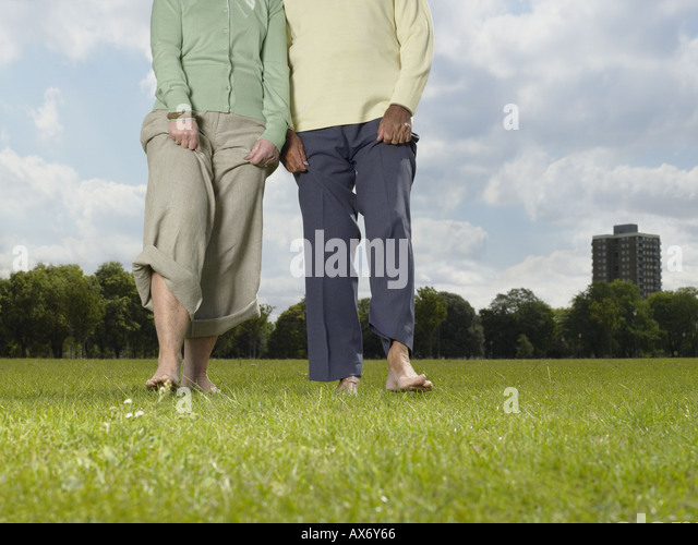 elderly-couple-walking-bare-foot-in-the-