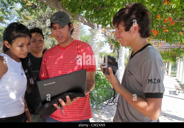 Mendoza Argentina Parque General San Martin public park garden pergola filming crew Hispanic man boy girl teen student - Stock Image