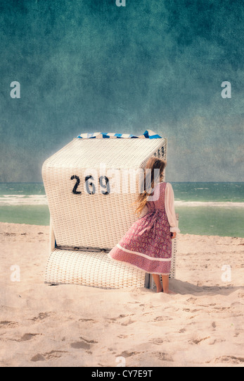 a girl and a beach chair - Stock Image