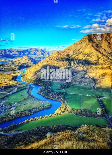 River and fields, New Zealand. - Stock Image
