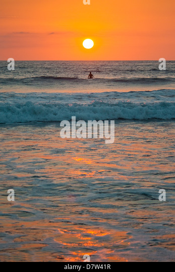 Sunset at Playa Guiones surfing beach, Nosara, Nicoya Peninsula, Guanacaste Province coast, Costa Rica - Stock Image