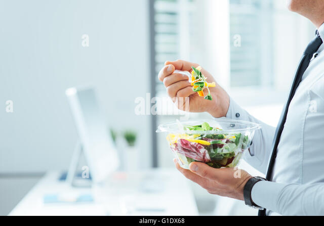 Businessman having a vegetables salad for lunch, healthy eating and lifestyle concept, unrecognizable person - Stock-Bilder