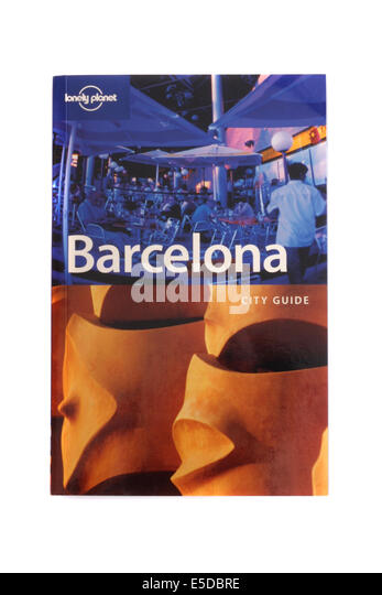 Lonely planet travel book to Barcelona on a white back ground. - Stock-Bilder