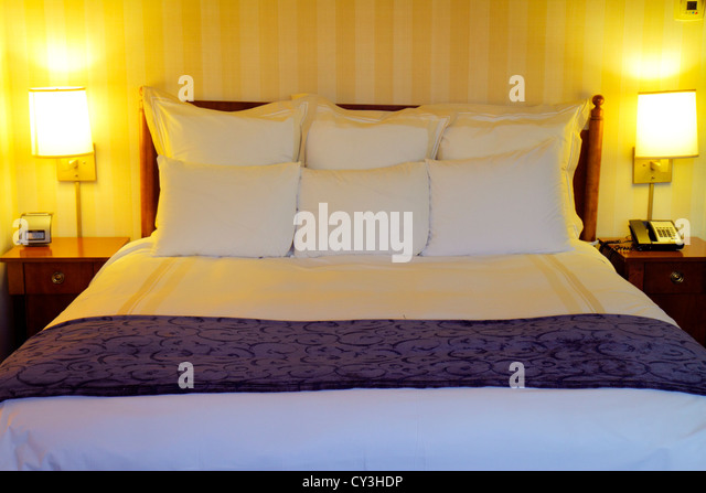 Boston Massachusetts Boston Marriott Peabody hotel guest room king-size made bed lamps pillows housekeeping - Stock Image
