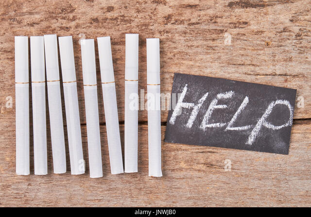 Help to overcome nicotine addiction. - Stock Image