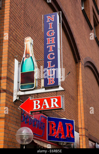 Nightclub and bar sign on the wall of a building in Bremen, Germany. - Stock Image