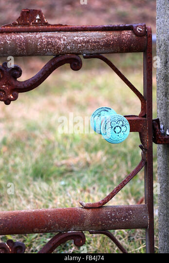 19th Century iron fence gate with an oxidized copper knowb found in a Nantucket, Massachusetts cemetery. - Stock Image