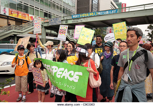 Greenpeace activists during an anti-nuclear protest march in Shibuya, Tokyo. - Stock Image