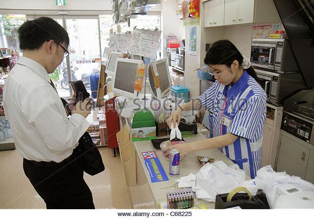 Japan Tokyo Ryogoku kanji hiragana katakana characters symbols Japanese English Lawson Convenience Store interior - Stock Image