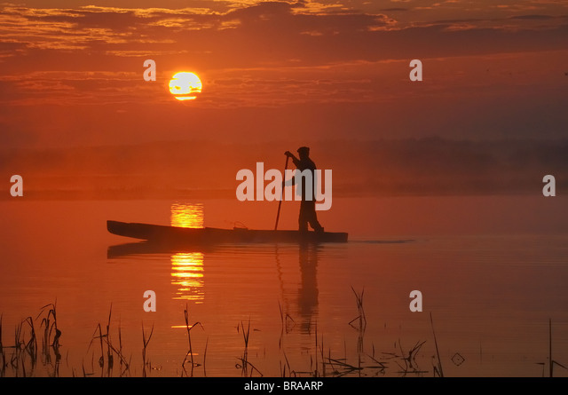 Traditional fishing punt at sunrise, Biebrza marsh, Poland - Stock-Bilder