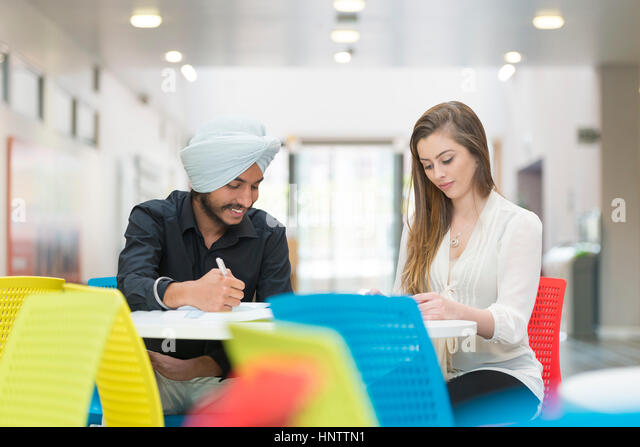 Students in a university setting, working together. - Stock Image