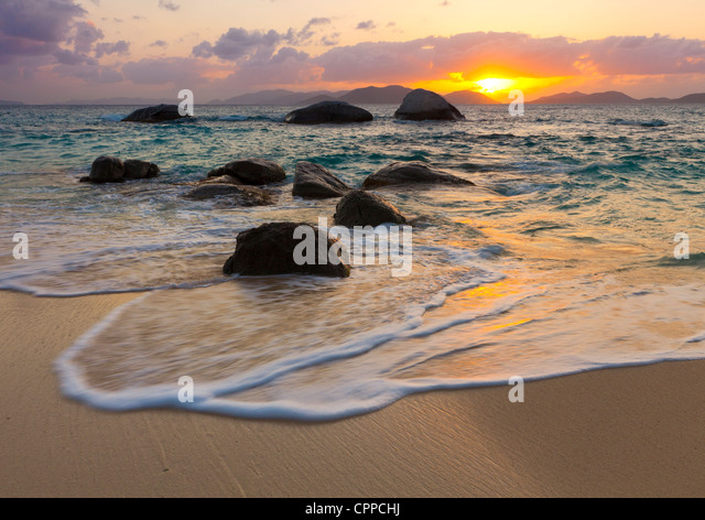 Virgin Gorda, British Virgin Islands, Caribbean Boulders awash in the surf of Little Trunk Bay - Stock Image