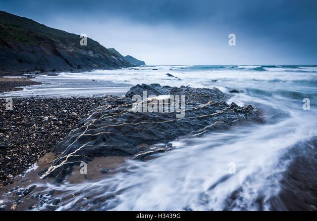 Crackington Haven beach and the headland of Cambeak, Cornwall, England. - Stock Image