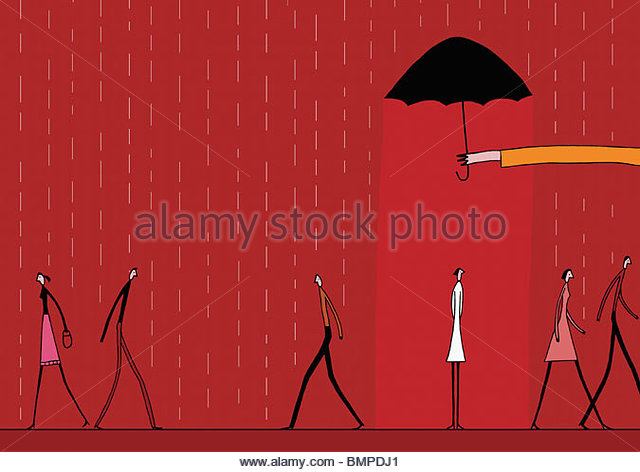 Hand holding umbrella over woman in rain - Stock Image