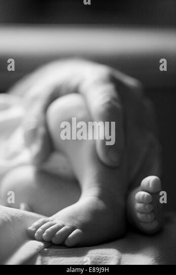 Father holding baby, close up - Stock-Bilder