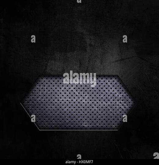 Dark grunge texture background with cutout showing perforated metal - Stock Image