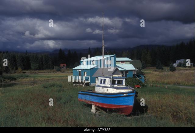 Boat and house near Gustavus Glacier Bay Alaska USA - Stock Image