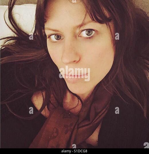 Selfie of brunette girl - Stock Image