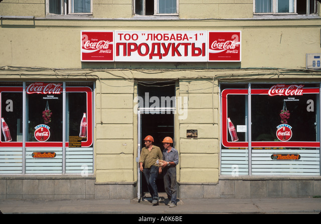 Russia former Soviet Union Moscow Coca Cola advertising storefront multinational company - Stock Image