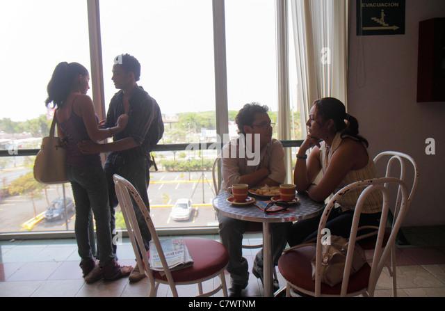 Managua Nicaragua Avenida Simon Bolivar Plaza Inter shopping mall food court coffee shop window table chair Hispanic - Stock Image