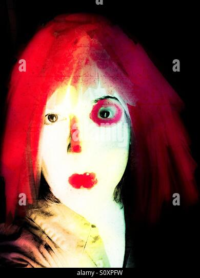 Pale Woman with Bright Red Hair - Stock Image