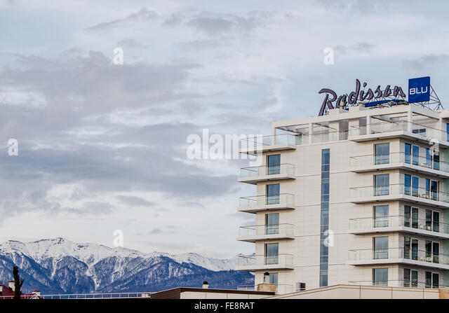 Radisson Blue Hotel, Sochi, in front of the Caucasus Mountains - Stock Image