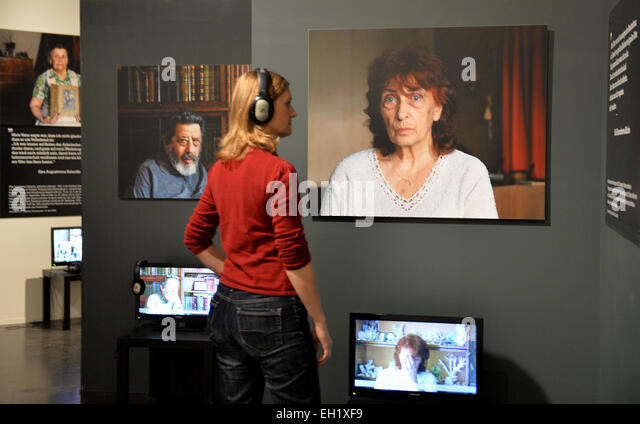 A visitor listens to an interview with Nelli Konstantinowa Kalinina, whose father, the aircraft designer Kalinin, - Stock Image