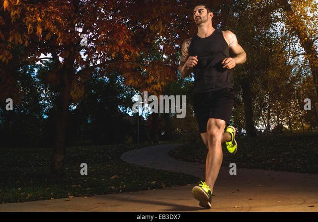 USA, Colorado, Broomfield County, Broomfield, Male athlete jogging - Stock Image
