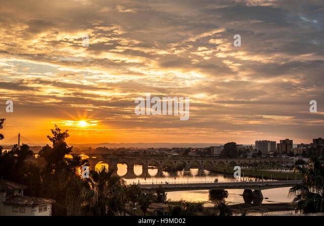 Four bridges of Badajoz City at sunset with cloudy sky, Spain - Stock Image
