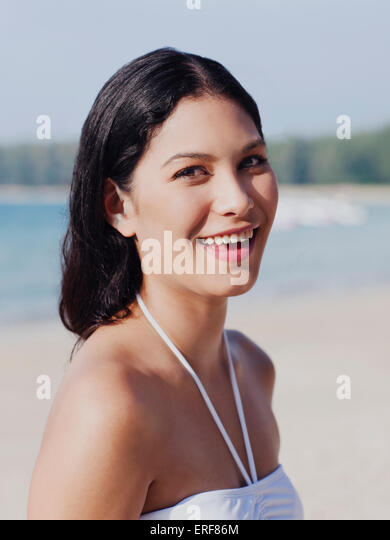 Woman in Bikini on Beach at Indigo Pearl, Phuket, Thailand. A woman stands on Nai Yang Beach which fronts Indigo - Stock Image