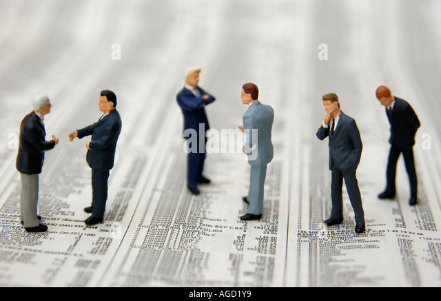Stock market / Economy concept - business men standing on stock market stocks and shares prices - Stock Image