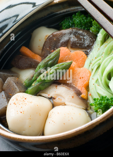 Fish Ball Stew Pot with Vegetables and Spinach Noodles - Stock Image