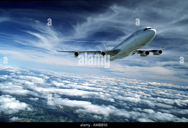 Airbus A340 above the clouds - Stock Image