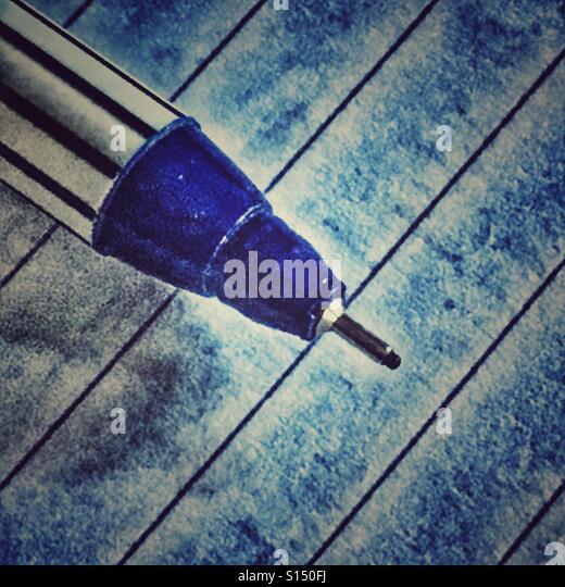 Blue felt tip writing pen on lined paper - Stock-Bilder