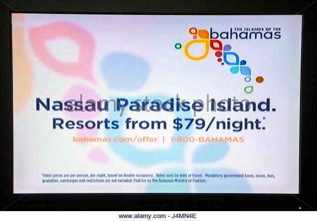 Miami Beach Florida flat panel TV television screen shot media ad advertisement commercial marketing Nassau Bahamas - Stock Image