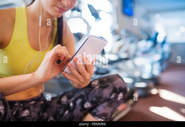 Beautiful woman in gym - Stock Image
