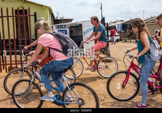 South Africa African Johannesburg Soweto bicycle bike house man woman - Stock Image
