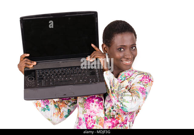 Young happy business woman showing her laptop to her colleagues isolated on white background - Stock Image