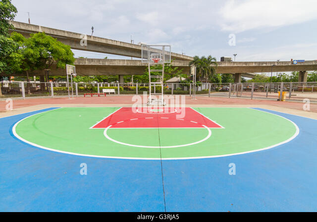 outdoor basketball court in local school - Stock Image