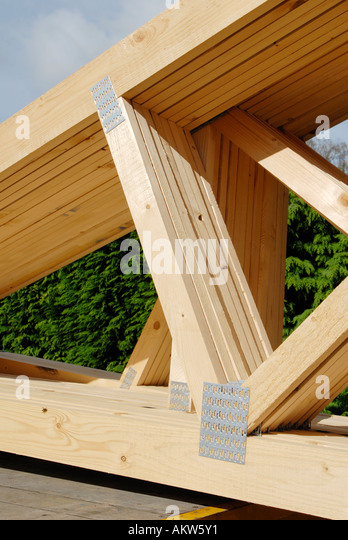 Timber roof joists ready for use on a construction site. England UK. - Stock-Bilder