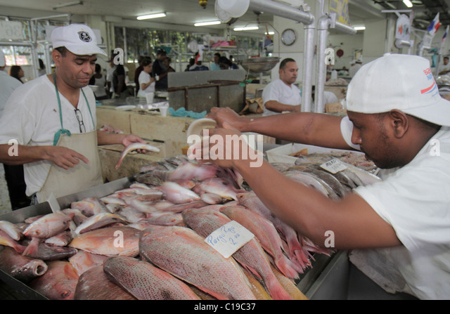 Panama City Panama Ancon Mercado de Mariscos market merchant selling shopping retail fresh fish seafood business - Stock Image