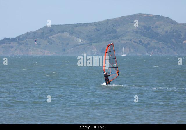 Man windsurfing in San Francisco bay - California USA - Stock Image