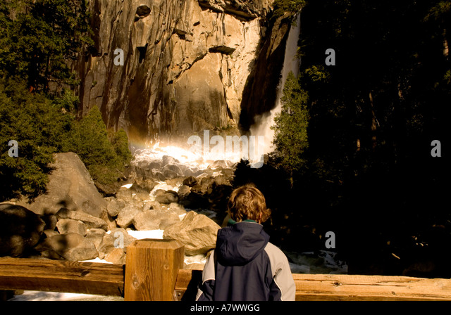 Yosemite Falls lower falls basin base pool  woman tourist - Stock Image