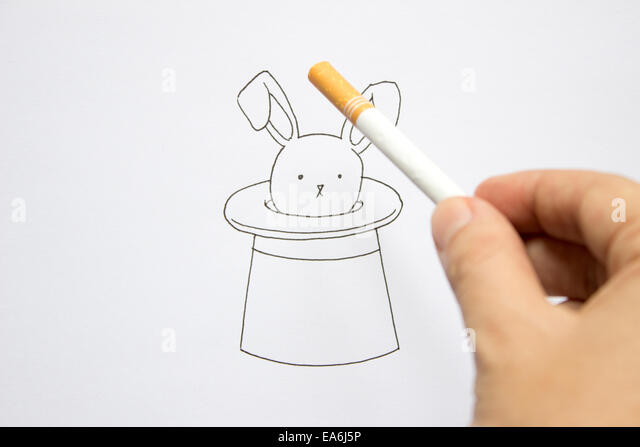 Conceptual magician's rabbit in hat - Stock Image