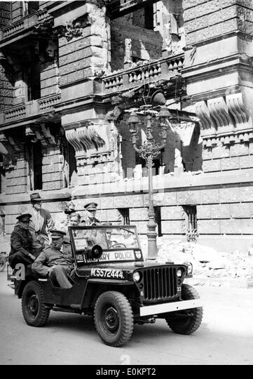 Sir Winston Churchill riding by destroyed Reichstag building in Berlin, Germany - Stock Image