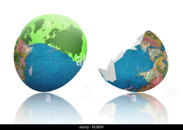 Green earth emerging from cracked egg shell world - Stock Image