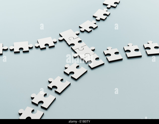 Jigsaw pieces bridging the gap - Stock Image